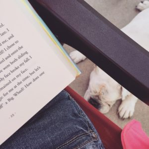 Reading outside with Sophie beside me.